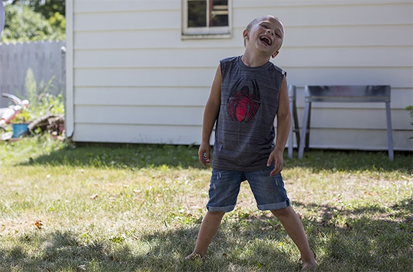 Landyn Dalek, who received a heart transplant at the University of Michigan Hospital, plays in his backyard.