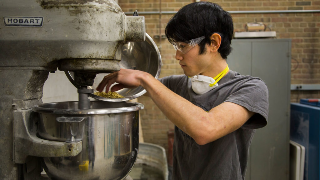 University of Michigan civil engineering student Isaya Miyata prepares a sample batch of concrete