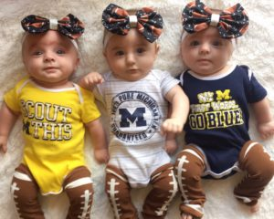 Triplets Rosie, Josie, and Ellie Buursma, two of whom were treated at the University of Michigan for plagiocephaly