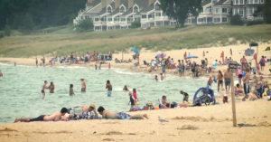 People relax at a Lake Michigan beach