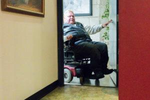 Access for All - man in wheel chair entering through door