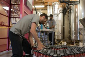 Brewery Vivant employees work in the warehouse