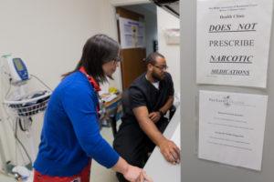 University of Michigan Nursing professor Gina Dahlem working at a shelter