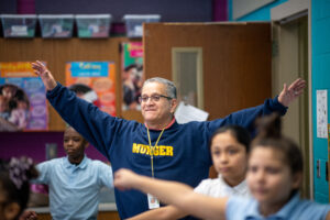 """Cesar Reyes, 5th grade Bilingual math teacher at Munger Elementary/Middle School in Detroit, says the kids love the University of Michigan's in-class exercise program, InPACT. """"The kids were the ones reminding me: 'Hey Mr. Reyes, it's time to dance!'"""""""