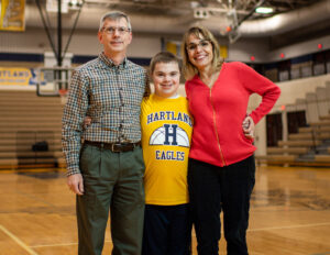 Jim and Jeanette Kurnick and their son Evan, who learned to walk on one of the custom treadmills 15 years ago