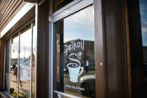 "Detroit Sip, which opened in 2017, is ""more than a coffee shop...it is your space, it is for the community."" The shop was helped by the University of Michigan's Detroit Neighborhood Entrepreneurs Project student team"