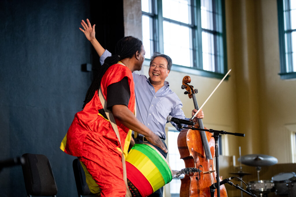 "Yo-Yo Ma and Flint musician Kevin ""Baba"" Collins delight the crowd at the Day of Action put on by the University of Michigan's University Musical Society (UMS)"