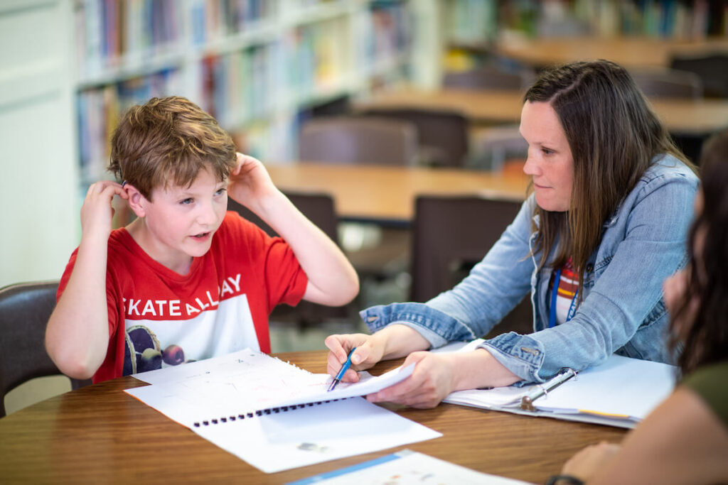 Kelly Kochanny, teacher consultant for the deaf and hard of hearing, works with Rhys, one of the young patients in the University of Michigan's Sound Support program, part of the U-M's Cochlear Implant program