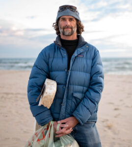 Photographer Marc Hoeksema cleaning up plastic waste at Lake Michigan