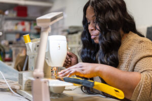 Sew Great Detroit teaches girls and women basic sewing skills as well as employment readiness skills
