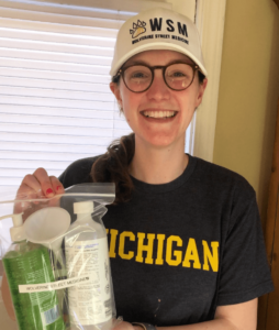 A University of Michigan medical student holds one of the kits distributed by Wolverine Street Medicine
