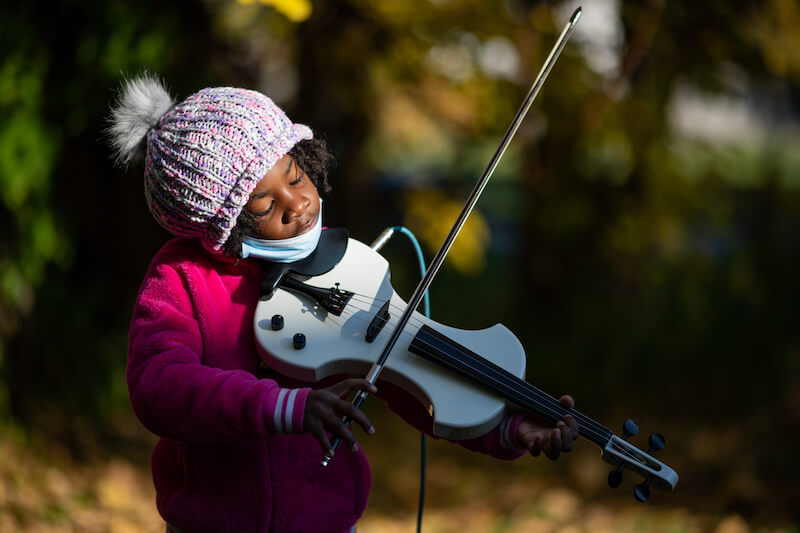 """[It's] a means for empowering these young kids to learn...how to figure out 'Hey, listen, I can do this. I can play the violin and I'm making beautiful music.'"" says Naomi André"