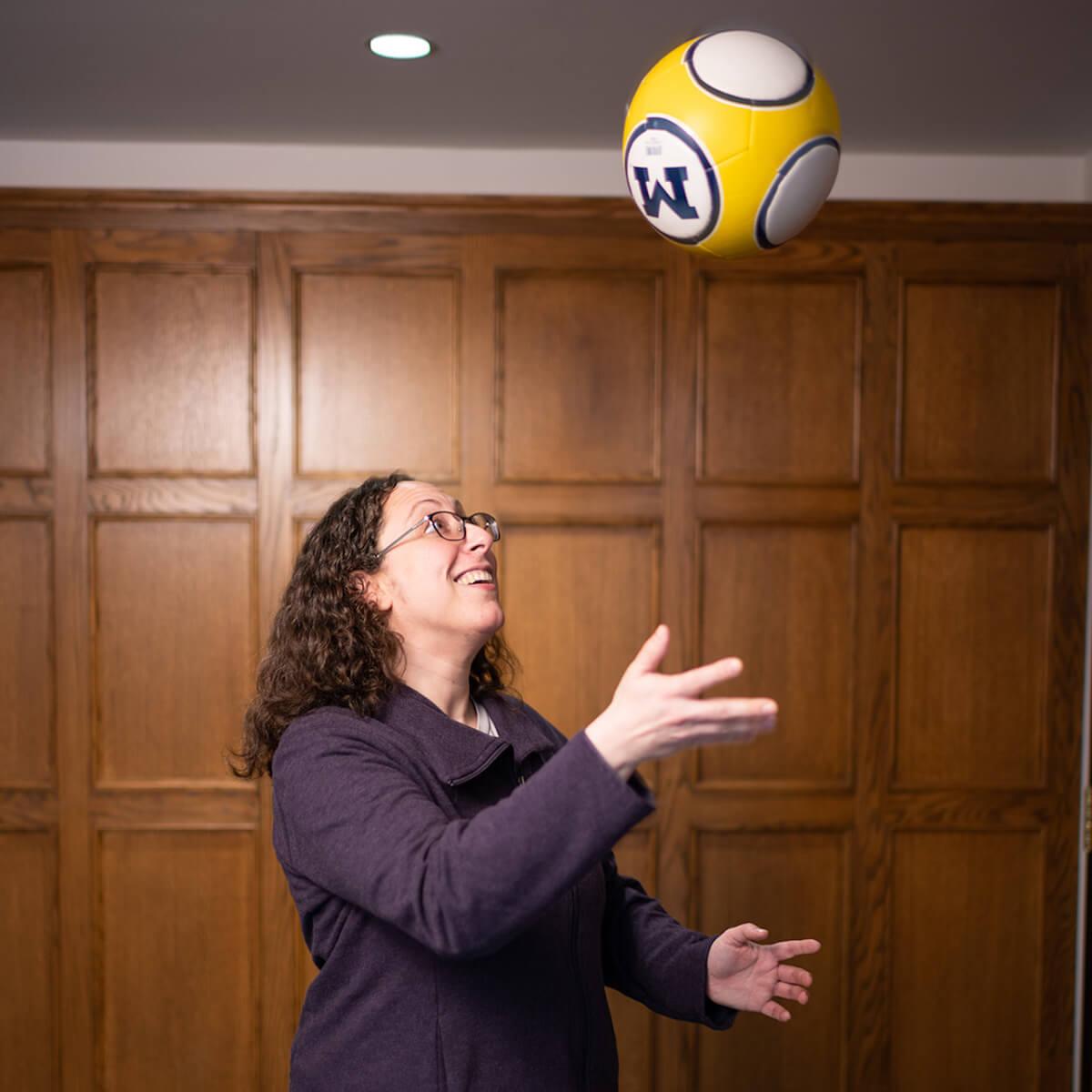Helene Fligiel, preventive medicine resident, University of Michigan School of Public Health, tosses a soccer ball