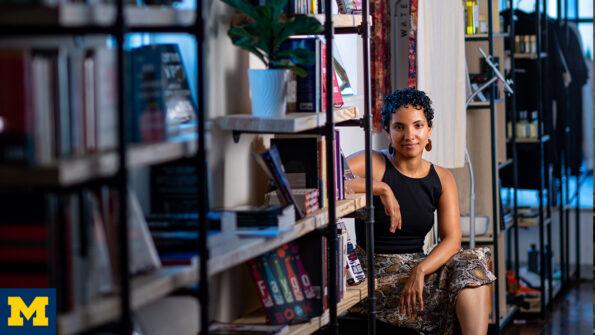 Egypt Otis sitting inside of her book store
