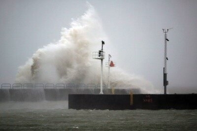 Waves on Lake Michigan crash over nearshore structures.