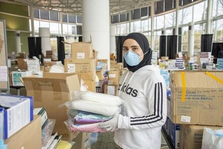 Image of an individual holding collected medical supplies