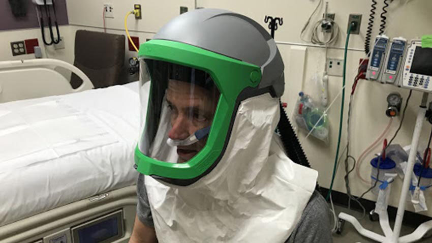 Kevin Ward, M.D., tests the negative pressure helmet system.