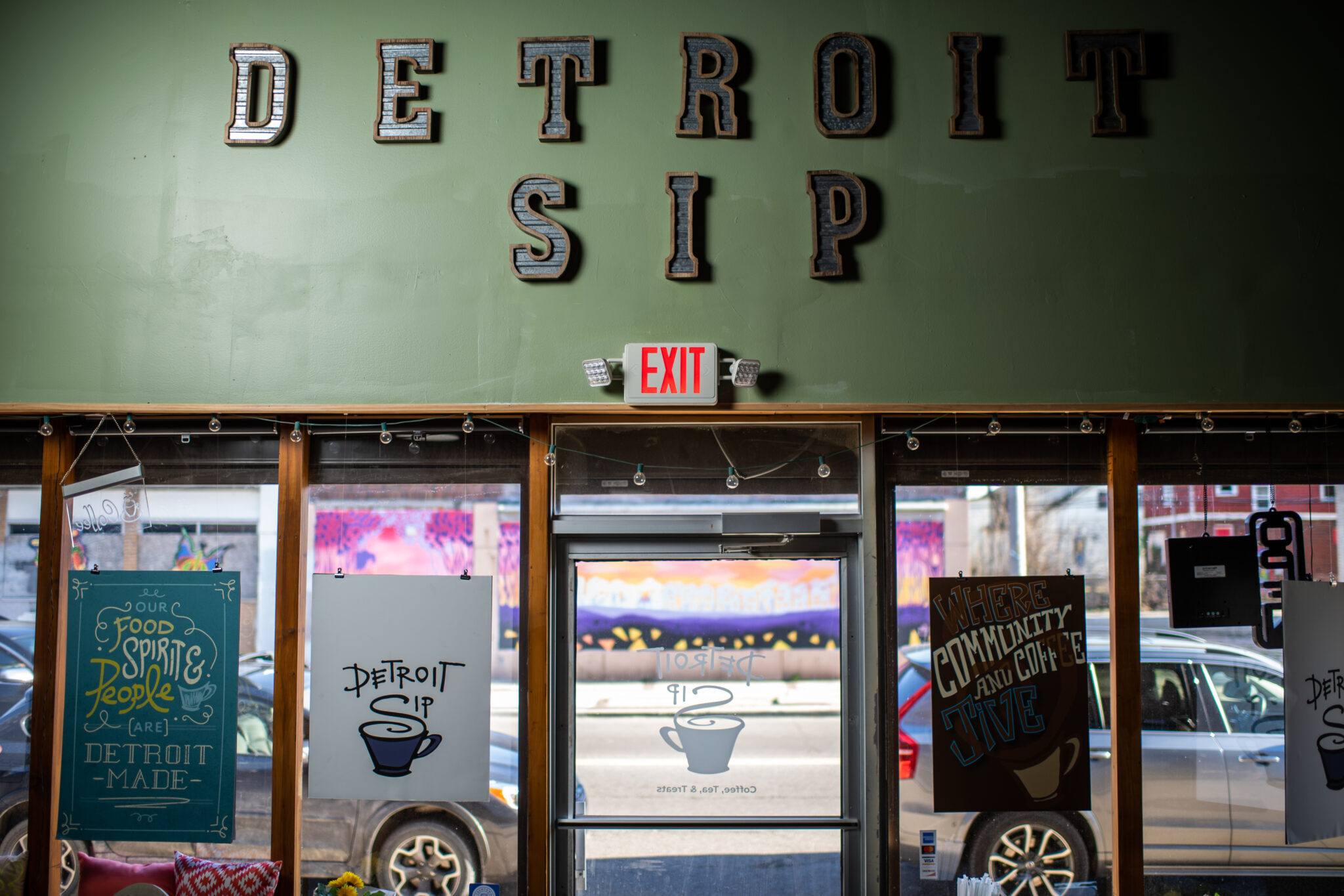 image of a coffee shop with the words Detroit Sip on the wall